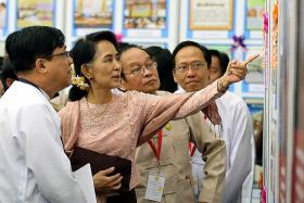 Suu Kyi calls for space to handle issue
