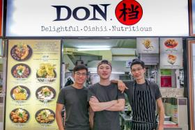 Mr Zilch Ng (middle) with some of his team members.