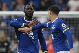 Everton's Romelu Lukaku celebrates scoring their second goal with Ross Barkley
