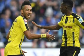 Dortmund, Monaco get licence to thrill