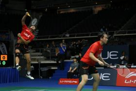 Reigning Olympic mixed doubles champions Tontowi Ahmad (left) and Liliyana Natsir in action at the OUE Singapore Open at the Indoor Stadium. The Indonesian pair crashed out of the tournament in the first round.