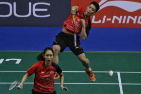 Singapore's mixed doubles pair of Terry Hee (top) and Tan Wei Han almost scored a major upset win over Chinese world No. 2 duo Lu Kai and Huang Yaqiong, but lost 17-21, 21-16, 22-20.