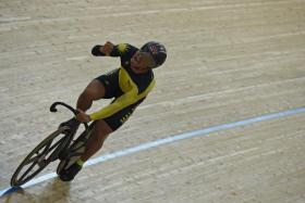Malaysia's Azizulhasni Awang letting out a scream after winning the men's keirin at the Track Cycling World Championships in Hong Kong on Thursday night.