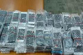 Eight men have been arrested under suspicion of selling counterfeit mobile phones.