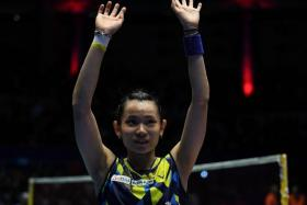 Taiwan's women's singles world No. 1 Tai Tzu-ying (above) beats Spain's Carolina Marin 21-15, 21-15 to win the OUE Singapore Open on Sunday.