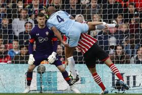 Manchester City's Vincent Kompany scores their first goal