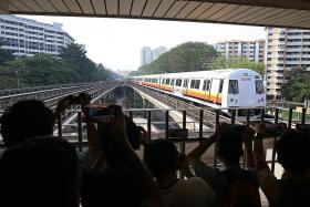 New SMRT train with LCD displays in service