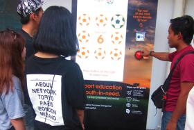 Catch the OrangeAid Give and Win stations at Nex, Income at Raffles (Collyer Quay) and Paya Lebar Square