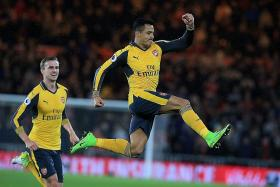 Wenger's back-three gamble pays off