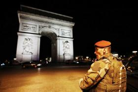 A soldier standing guard near the Arc de Triomphe after the shooting at the Champs Elysees in Paris.