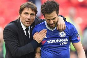 Chelsea manager Antonio Conte hugs Cesc Fabregas after winning the  FA cup semifinal