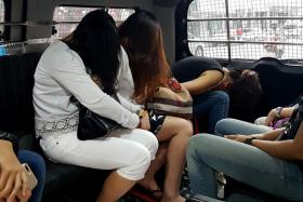 Two massage parlours at Rangoon Road were raided on Wednesday
