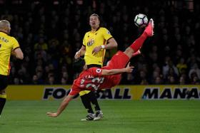 Liverpool's German midfielder Emre Can connects with this overhead kick to open the scoring in the EPL match against Watford