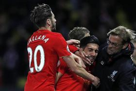Klopp relishes the pressure in top-four bid