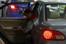 Grab and Uber employ 'ambassadors' to woo rival drivers