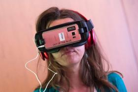 Director Sophie Ansel watches her movie at the Virtual Reality Corner during the Colcoa French Film Festival