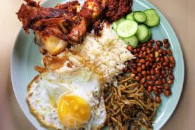 The signature Nasi Lemak (above). Chef Lee Eng Su at The Coconut Club. Other options include Sambal Lala and Otah.