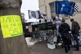Tottenham Hotspur fans shopping for merchandise outside White Hart Lane.