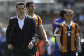Hull City manager Marco Silva looks dejected after the match