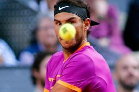 r Rafael Nadal returns the ball to Austrian tennis player Dominic Thiem during their ATP Madrid Open final match in Madrid