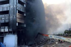 Two workers in Punggol fire rescued and taken to hospital