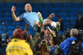 Manchester City's Argentinian defender Pablo Zabaleta is thrown in the air by his teammates as they and the crowd pay him tribute for his final home appearance for the club
