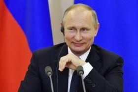 Russian President Vladimir Putin (above)