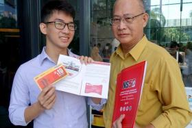 Mr Melvin Tan De Zheng and his father Dave Tan Jong were among the 500 national servicemen who received their NS50 packages at ceremonies on 9 April 2017.