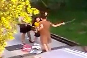 A screengrab of a man and woman hitting their daughter in public.