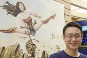 Sonny Liew with his Wonder Woman illustration.