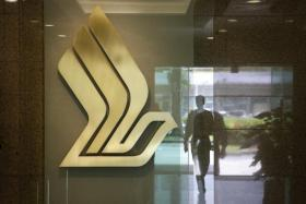 A silhouette is reflected next to the SIA logo in the lift lobby at Airline House.