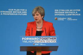 Conservatives' election lead halved