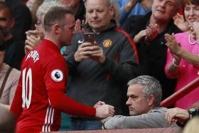 Wayne Rooney with Manchester United manager Jose Mourinho after he is substituted