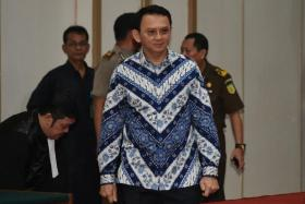 Jakarta's Christian governor Basuki Tjahaja Purnama, popularly known as Ahok, arriving at a courtroom for his verdict and sentence in his blasphemy trial in Jakarta on May 9.