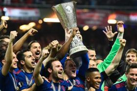 Red Devils claim treble and Champions League spot