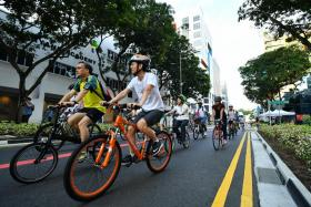 Cyclists cycling on Bencoolen Street, during the official launch of the revitalised Bencoolen Street, in conjunction with this month's special edition of Car-Free Sunday SG, on May 28, 2017.