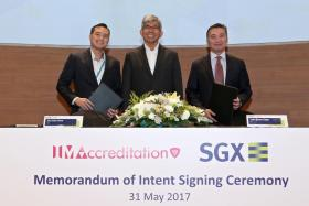 (From left) IMDA chief executive Tan Kiat How, Minister for Communications and Information Yaacob Ibrahim and SGX chief executive Loh Boon Chye.