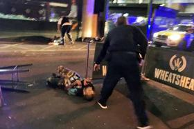 The three attackers wearing fake suicide vests were shot dead by police