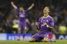 Real Madrid's Cristiano Ronaldo celebrates after winning the UEFA Champions League Final