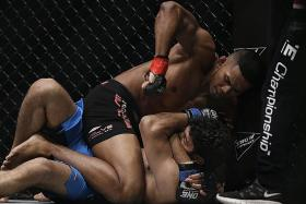 Fighter Amir: 'I'll be first male Singaporean MMA world champ'