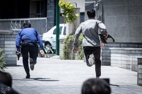 Members of Iranian forces run during an attack on the Iranian parliament in central Tehran, Iran, June 7, 2017.