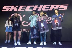 Chanyeol, Suho and Sehun of EXO on stage at Causeway Point