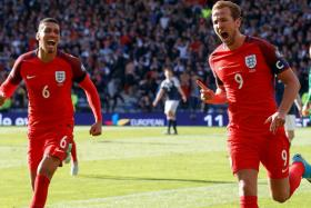Harry Kane (R) of England celebrates with his teammate Chris Smalling (L) after scoring the 2-2 equalizer