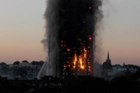 More than 200 firefighters, backed up by 40 fire engines, fighting the fire at Grenfell Tower block in central London.