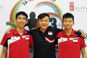 (L to R) Cadet doubles paddler Pang Yew En Koen, coach Dong ShiFei and cadet doubles paddler Dominic Koh after they clinched the Cadet Doubles Gold medal at the SEA Junior and Cadet Table Tennis Championships.