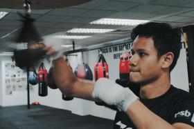 Singapore's first World Champion professional boxer, Muhamad Ridhwan