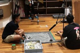 Students creating sound effects for a film in the Foley Live Room.
