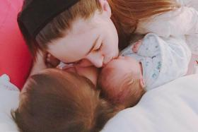 Jay Chou confirmed the birth of his second child with this photo of his wife Hannah Quinlivan and their two children on Facebook.