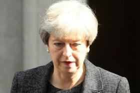 May survives first parliamentary test after snap election