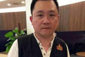 Goh Ting Chee is accused of posing as a reporter from Shin Min Daily News and cheating a hawker.